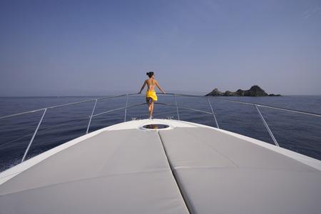 oceanic: Woman Standing on Bow of Yacht, Girolata Marine Park, Corsica, France