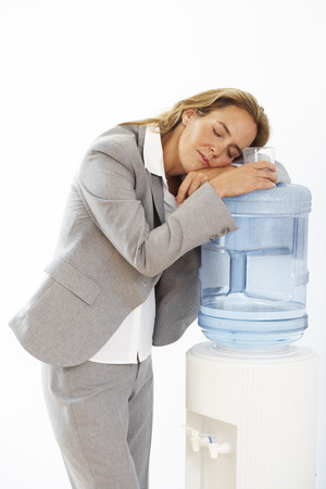 inebriated: Businesswoman Asleep on the Water Cooler