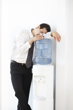 inebriated: Businessman Asleep on the Water Cooler