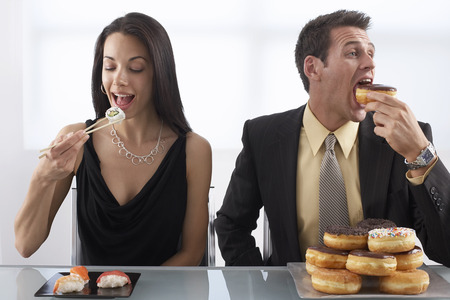 comparable: Woman Eating Sushi and Man Eating Doughnuts