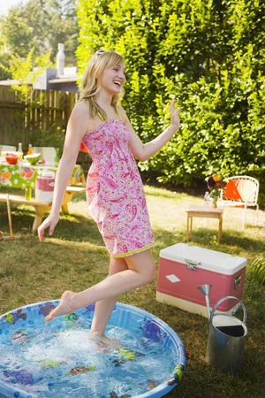 socialise: Woman in Wading Pool at Backyard Barbeque, Portland, Oregon, USA