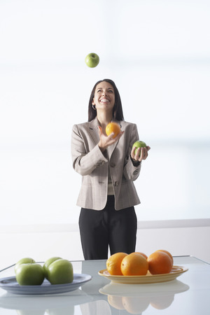 comparable: Businesswoman Juggling Apples and Oranges