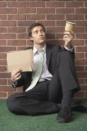 societal: Businessman Begging