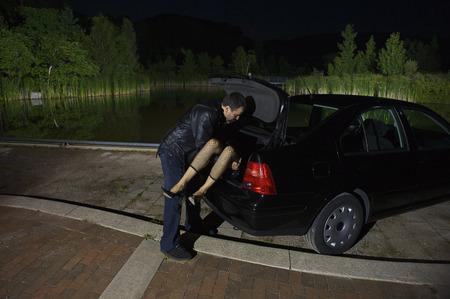skepticism: Man Disposing of Womans Body