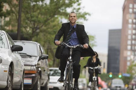 road cycling: Businessman Cycling to Work