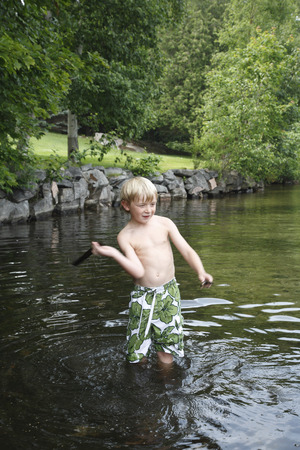 vómito: Boy Standing in Shallow Water