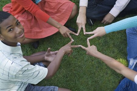 Group of Teens Making a Star