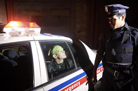 skepticism: Police Officer Arresting Suspect
