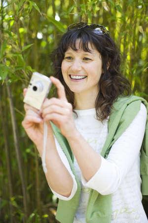 Woman Taking Pictures, San Francisco, California, USA