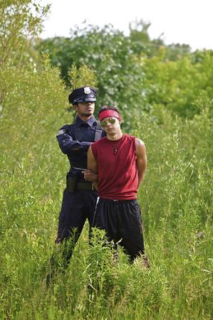 Police Officer Arresting Suspect
