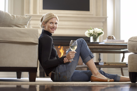 end of a long day: Woman with Glass of Wine in Living Room