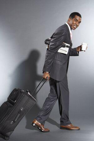 Businessman Leaving For Business Trip LANG_EVOIMAGES