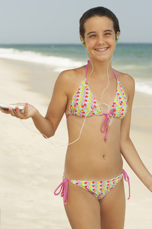 Girl on Beach With Mp3 Player