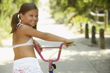 Girl Riding Bicycle LANG_EVOIMAGES