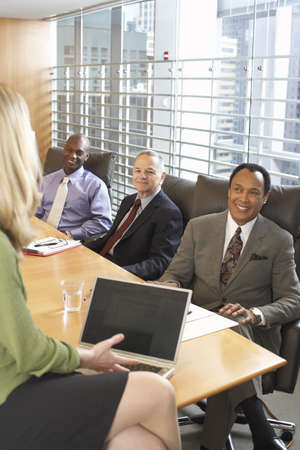 Business Meeting in Boardroom LANG_EVOIMAGES