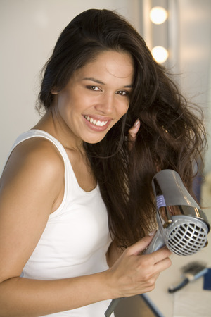 Portrait of Woman Blow Drying Her Hair