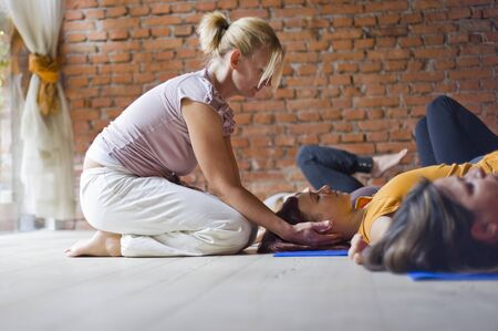 Women in Yoga Class With Instructor