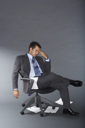 Frustrated Businessman With Documents on the Floor LANG_EVOIMAGES