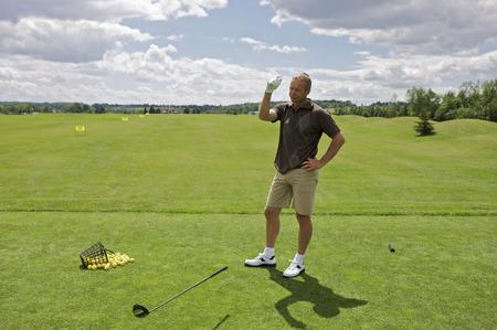Man at Driving Range Throwing Golf Club, Burlington, Ontario, Canada