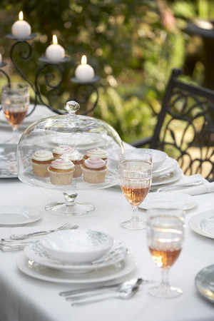 Tray of Cupcakes on Table Set for Dinner Party