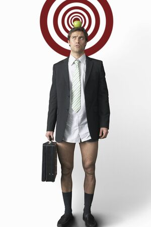 Businessman with Apple on Head and No Pants LANG_EVOIMAGES