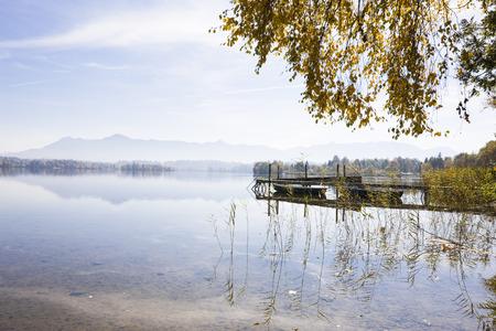 Dock on Lake Staffelsee in Autumn, Bavaria, Germany LANG_EVOIMAGES