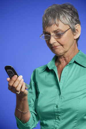 glower: Frustrated Woman Looking at Cell Phone