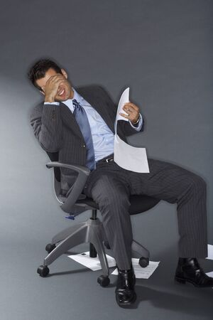 disapprove: Frustrated Businessman Holding Documents LANG_EVOIMAGES