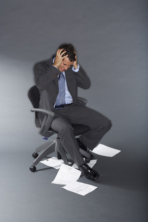 disapprove: Frustrated Businessman With Documents on the Floor LANG_EVOIMAGES