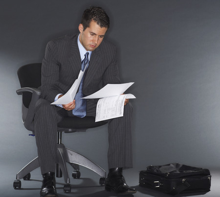 disapprove: Businessman Reading Documents