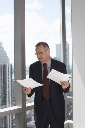 comparable: Businessman Looking at Documents