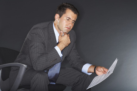 disapprove: Businessman Reading Document
