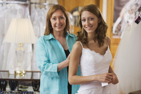 tailored: Bridal Shop Owner Helping Bride With a Dress Fitting