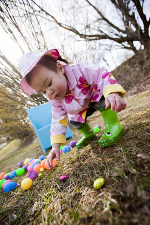 Little Girl Searching for Easter Eggs in the Park, Bethesda, Maryland, USA