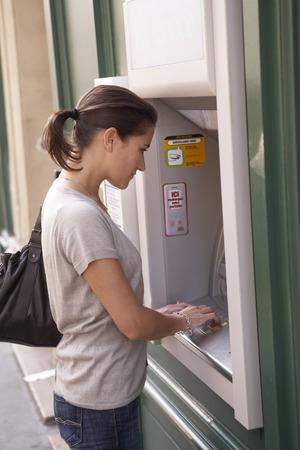 Woman using Bank Machine, Paris, France