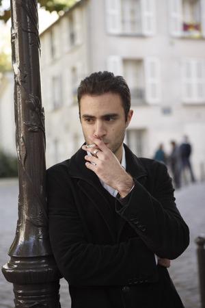 Man Leaning on Lamppost Smoking Cigarette, Paris, France
