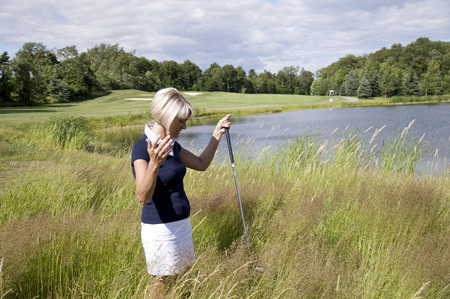 Golfer Searching for Ball in Tall Grass