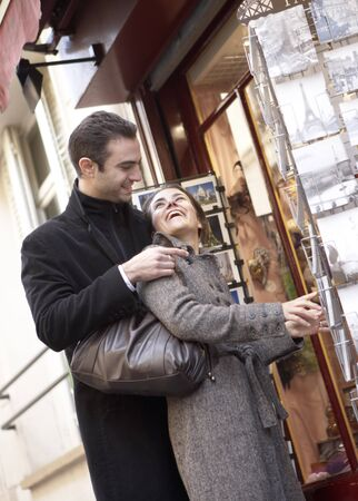 customer facing: Couple Looking at Postcards, Paris, France LANG_EVOIMAGES