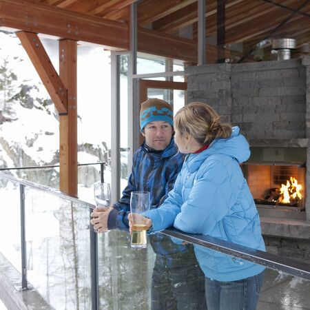 rafters: Man and Woman Standing on Chalet Balcony, Whistler, British Columbia, Canada