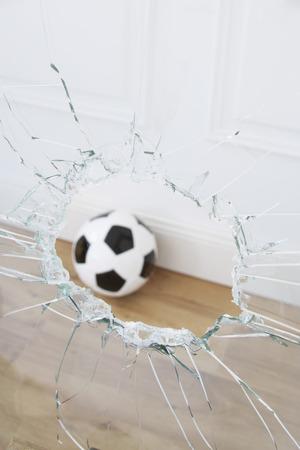 careless: Soccer Ball and Broken Window