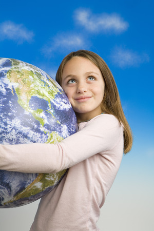 particulate: Little Girl Holding a Model of Earth as Seen From Outer Space