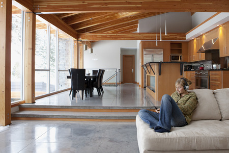 rafters: Woman at Home Listening to Music