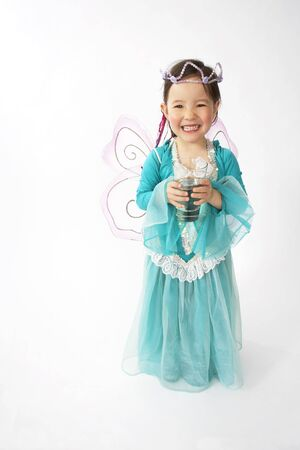 Girl Dressed as Fairy LANG_EVOIMAGES