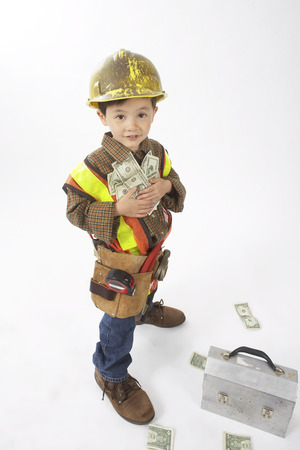 vocational high school: Boy Dressed Up as Construction Worker Holding Money