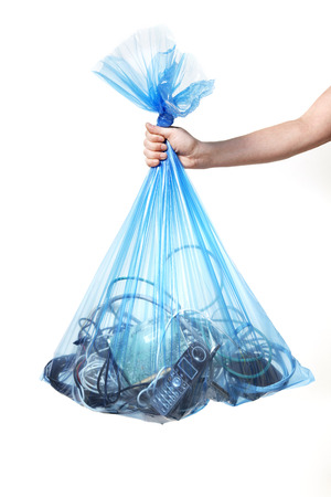 environmental issues: Person Holding Blue Recycling Bag Full of Electronics