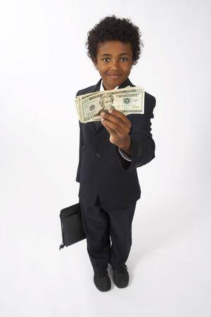 vocational high school: Boy Holding Money LANG_EVOIMAGES