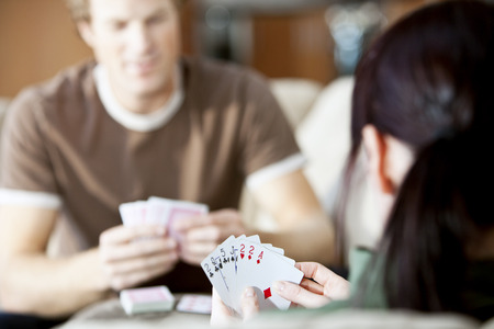 adversaries: Couple Playing Cards LANG_EVOIMAGES