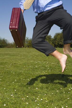 Businessman Clicking His Heels LANG_EVOIMAGES