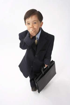 vocational high school: Little Boy Dressed Up as a Businessman LANG_EVOIMAGES