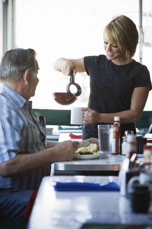 Waitress Seving Coffee to Man